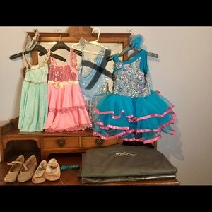 Lot of dance costumes and shoes